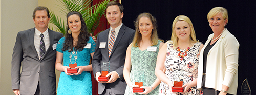 Students standing with Dean receiving Honors Program medals